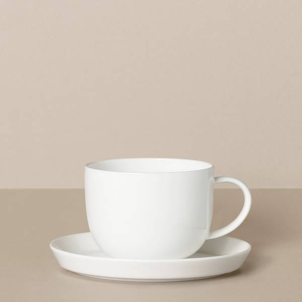 Cup and saucer in white